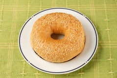 Bagel. On the white plate royalty free stock photo