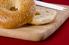 Bagel. With sesame seeds on wooden plank, close-up royalty free stock photography