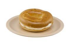Bagel avec le fromage fondu Photographie stock