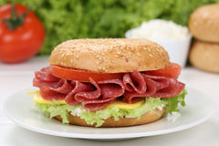 Bagel for breakfast with salami ham Stock Images