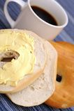 Bagel with butter cream Royalty Free Stock Photos