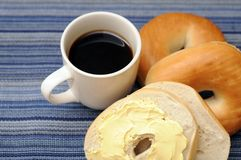 Bagel with butter cream and coffee Stock Photography