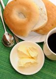 Bagel with butter cream and coffee Royalty Free Stock Photos