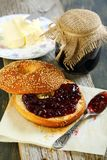 Bagel with butter and jam for breakfast. Stock Photography