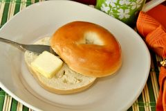 Bagel with butter Stock Image