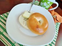 Bagel with butter Stock Photos