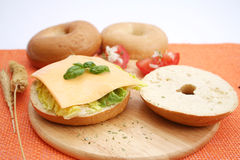 A bagel with cheese. A fresh bagel with cheese and salad stock photography