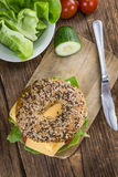 Bagel with Cheese (Gouda). And some fresh vegetables (close-up shot; selective focus Royalty Free Stock Photography