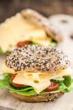Bagel with Cheese (Gouda). And some fresh vegetables (close-up shot; selective focus Stock Photos