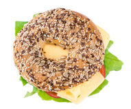 Bagel with Cheese (Gouda). And some fresh vegetables (close-up shot; selective focus Royalty Free Stock Photos