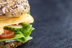 Bagel with Cheese (Gouda). And some fresh vegetables (close-up shot; selective focus Stock Photography