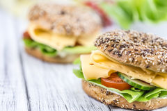 Bagel with Cheese (Gouda). And some fresh vegetables (close-up shot; selective focus Stock Image