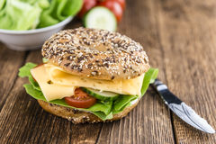 Bagel with Cheese (Gouda). And some fresh vegetables (close-up shot; selective focus Stock Images