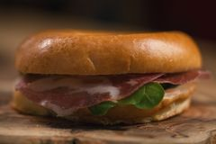 Bagel with coppa and cream cheese on wood boar. D, shallow focus Royalty Free Stock Photos