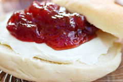 Bagel with cream cheese. Macro of plain bagel with cream cheese and strawberry preserves Royalty Free Stock Image
