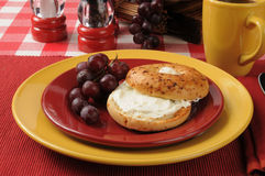 Bagel with cream cheese and grapes Stock Photo