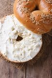Bagel with cream cheese and sesame  vertical top view Royalty Free Stock Image