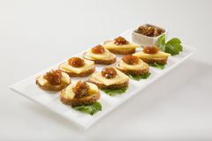 Bagel crisps with chutney and cheese Stock Image