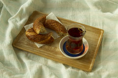 Bagel and cup of turkish tea on the wood tray with Istanbul pict Stock Photos