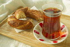 Bagel and cup of turkish tea on the wood tray with Istanbul pict Royalty Free Stock Images
