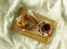 Bagel and cup of turkish tea on the wood tray with Istanbul pict Stock Photography