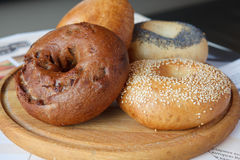 Bagel. Delicious fresh bagels on a wooden platter Stock Photography