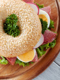Bagel with egg and salami Royalty Free Stock Images