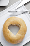 Bagel with a heart-shaped hole Royalty Free Stock Photo