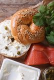 Bagel and ingredients: fish, cheese, capers vertical top view Stock Photos