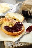Bagel with jam and butter. Royalty Free Stock Images