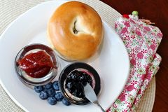 Bagel with jelly and blueberries Stock Photography