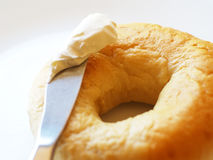 Bagel, knife, and cream cheese royalty free stock images