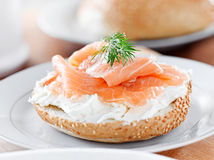 Bagel and lox with sprig of dill stock images