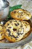Bagel with nigella. Fresh baked bagel with nigella royalty free stock images