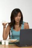 Bagel no computador Foto de Stock
