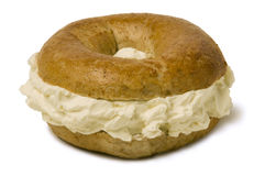 Bagel Overstuffed with Cream Cheese Royalty Free Stock Photos