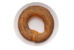 Bagel. With poppy seeds is on plate royalty free stock photos