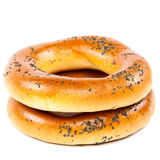 Bagel with poppy seeds on white background. Stock Photos
