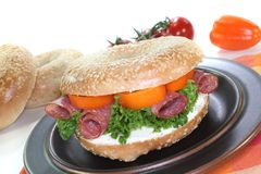 Bagel with salami Royalty Free Stock Image
