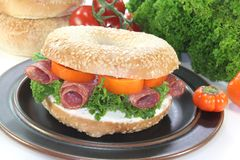 Bagel with salami Stock Images