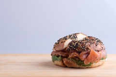 Bagel with salmon cut in half Stock Photo