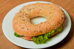 Bagel with salmon on a plate Royalty Free Stock Photo