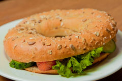 Bagel with salmon on a plate Royalty Free Stock Photos