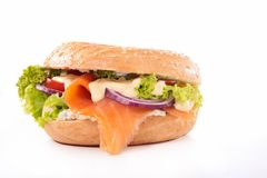 Bagel with salmon. On white stock photo