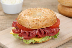 Bagel sandwich for breakfast with salami ham Royalty Free Stock Images
