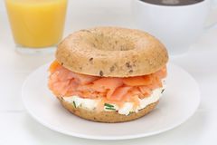 Bagel sandwich for breakfast with salmon fish, orange juice and Royalty Free Stock Photography