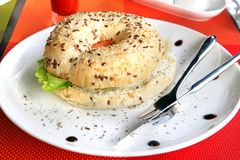 Bagel sandwich with lettuce, tomato and salted salmon Stock Image