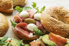 Bagel sandwich with prosciutto and mozzarella cheese. Bagel sandwich with prosciutto and mozzareela cheese. Healthy food royalty free stock image