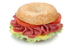 Bagel sandwich with salami ham isolated Stock Images