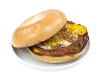 Bagel with sausage breakfast sandwich on plate Stock Images